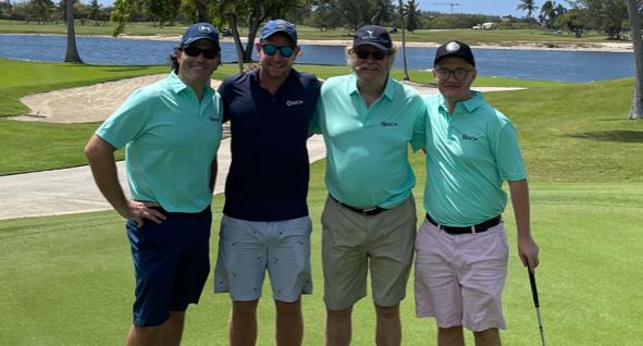 GCM team members golfing